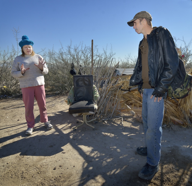 Homeless Marine veteran Michael Coughlin, right, visits with Kara Lyons at a homeless encampment near Lake Mead Boulevard and North Simmons Street in Las Vegas Friday, Dec. 13, 2013. Coughlin, who ...