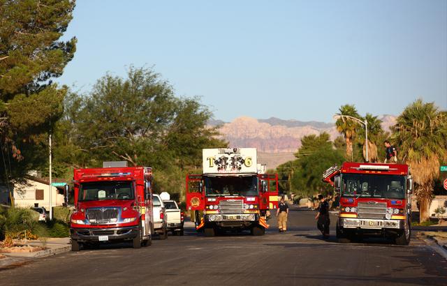 Las Vegas and Clark County fire department crews respond to a house fire off Tara Avenue, near Rainbow Boulevard and Sahara Avenue, on Monday, Aug. 25, 2014. Las Vegas police shut down a portion o ...