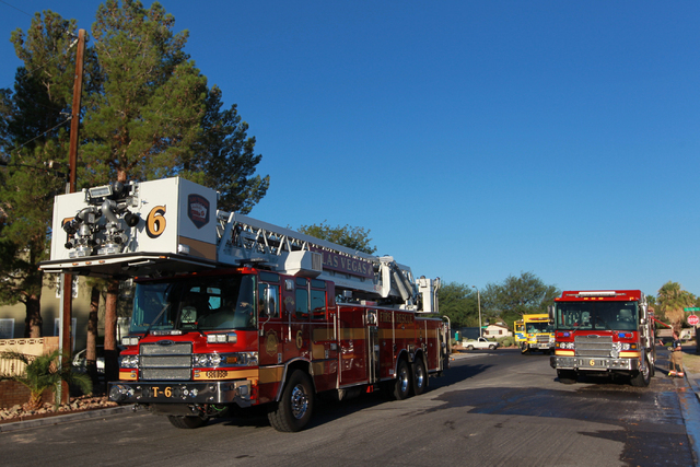 Las Vegas and Clark County fire department crews respond to a house fire off Tara Avenue near Rainbow Boulevard and Sahara Avenue in Las Vegas on Monday, Aug. 25, 2014. The fire was contained to t ...