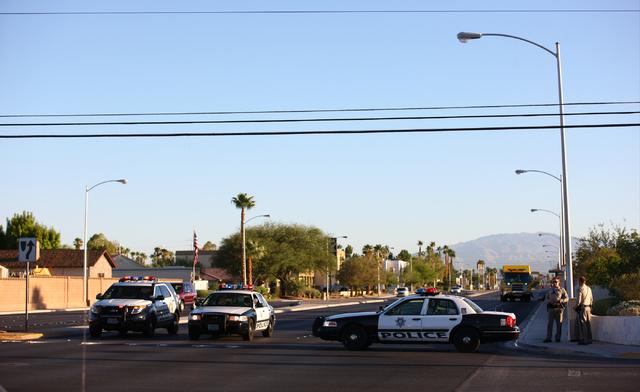 Las Vegas police block northbound Rainbow Boulevard near Sahara Avenue Monday, Aug. 25, 2014, as Las Vegas and Clark County fire department crews respond to a house fire off Tara Avenue. (Chase St ...