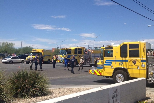 Clark County Fire Department and police respond to a crash involving a truck and a sedan at Boulder Highway and Russell Road in Las Vegas on Wednesday, Aug. 20, 2014. Police closed down part of no ...