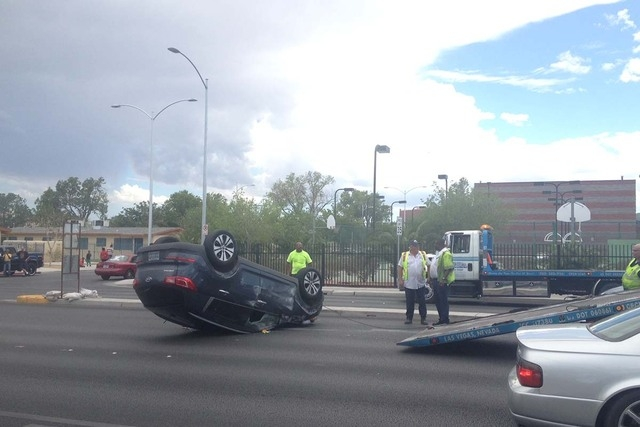 Las Vegas Fire Department responds to a rollover accident at the intersection of Martin Luther King Boulevard and Washington Avenue on Wednesday, August 20, 2014. (Chase Stevens/Las Vegas Review-J ...