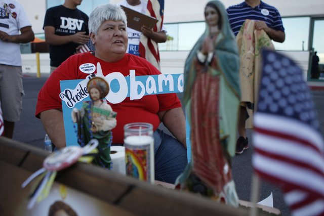 Activist Maria Guadalupe Arreola participates during a vigil to call on President Obama to use executive order powers to allow families to stay in the country legally at the U.S. Department of Hom ...