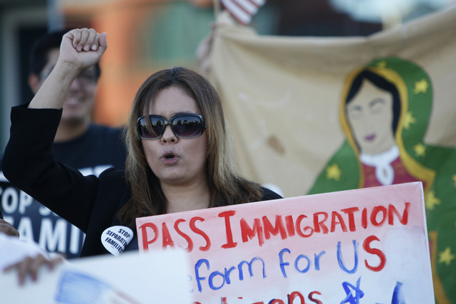 Sharon Courtney participates during a vigil to call on President Obama to use executive order powers to allow families to stay in the country legally at the U.S. Department of Homeland Security in ...
