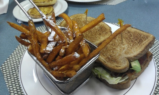 The Blast Sandwich (bacon, lettuce, tomato, avocado and Swiss cheese) is shown at Jamms, 1029 S. Rainbow Blvd., with a side of sweet potato fries. (Lisa Valentine/View)