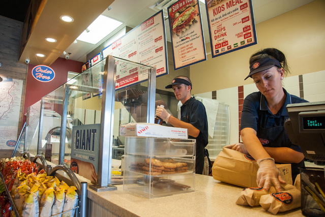 Jersey Mike's Subs employees, David Amman, left, and Hilary Glenn work the counter of the sandwich shop on 7390 S. Las Vegas Blvd., in Las Vegas Thursday, July 31, 2014. (Martin S. Fuentes/Las Veg ...