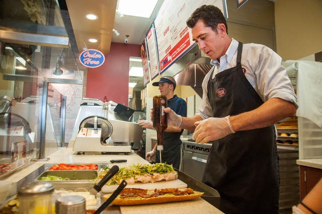 Co-owner Sean Mapes of Jersey Mike's Subs makes a sandwich at his shop on 7390 S. Las Vegas Blvd., in Las Vegas Thursday, July 31, 2014. (Martin S. Fuentes/Las Vegas Review-Journal)