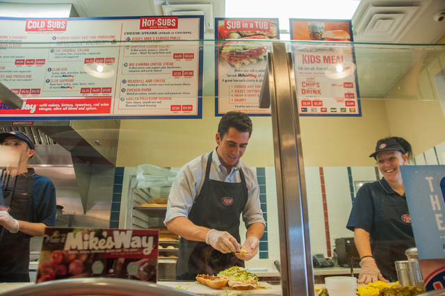 Co-owner Sean Mapes, center, of Jersey Mike's Subs makes a sandwich as employee Hilary Glenn, right looks on, at his shop on 7390 S. Las Vegas Blvd., in Las Vegas Thursday, July 31, 2014. (Martin  ...