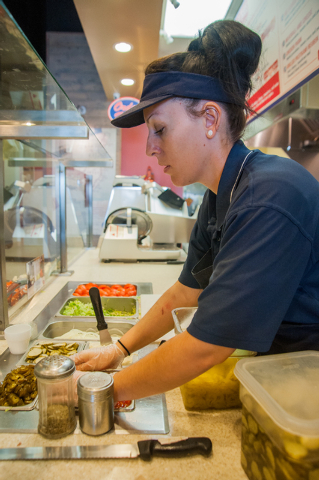 Jersey Mike's Subs employee Hilary Glenn works the counter of the sandwich shop on 7390 S. Las Vegas Blvd., in Las Vegas Thursday, July 31, 2014. (Martin S. Fuentes/Las Vegas Review-Journal)
