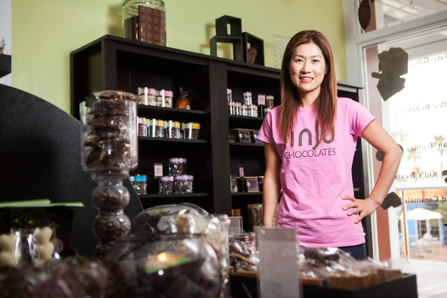 Chocolatier Jin Caldwell poses for a photo at her store, Jinju Chocolates, at the Downtown Container Park in Las Vegas on Tuesday, July 15, 2014. (Chase Stevens/Las Vegas Review-Journal)