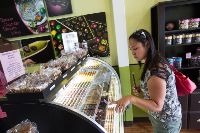 Toni Crowel of Moose Lake, Minn., looks through items at Jinju Chocolates in the Downtown Container Park in Las Vegas on Tuesday, July 15, 2014. (Chase Stevens/Las Vegas Review-Journal)