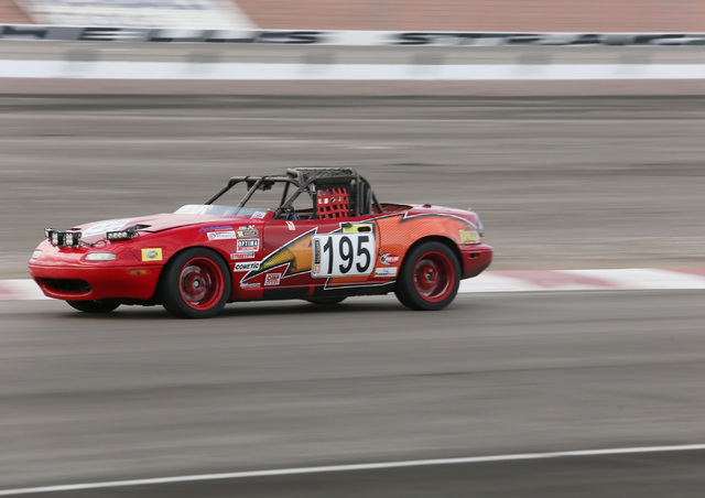 A modified 1991 Mazda Miata, belonging to team The Door Slammers, of Alta Loma, Calif., is shown racing during the ChumpCar World Series 13-hour endurance race at Las Vegas Motor Speedway Sunday,  ...