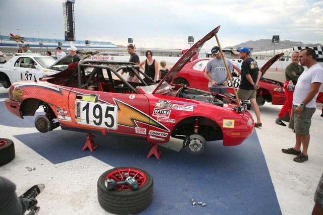 People view a modified 1991 Mazda Miata, belonging to team The Door Slammers, of Alta Loma, Calif., after the ChumpCar World Series 13-hour endurance race at Las Vegas Motor Speedway Sunday, Aug.  ...