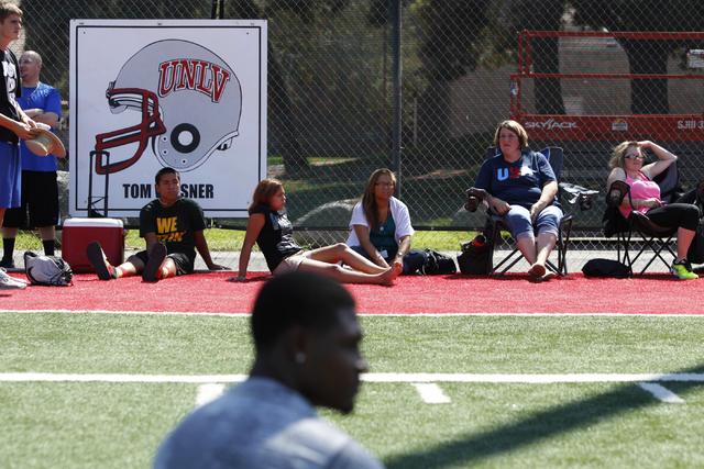 "Family members watch children participating during the Royal Purple Las Vegas Bowl Youth Football Clinic at Bill ""Wildcat"" Morris Rebel Park at UNLV Tuesday, Aug. 5, 2014. (Erik Verduzco ..."