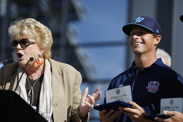 Las Vegas Mayor Carolyn Goodman, left, presents Mountain Ridge Little League manager Ashton Cave with the key to the city for his team's performance in the Little League World Series during a cere ...