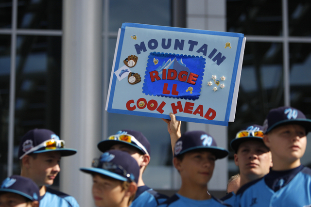 Mountain Ridge Little League players stand as they are honored during a ceremony for their Little League World Series performance at Las Vegas City Hall in Las Vegas Saturday, Aug. 30, 2014. (Erik ...