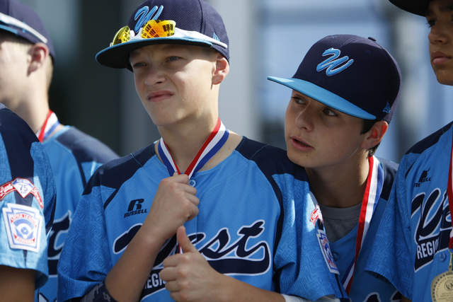 Mountain Ridge Little League players Justin Hausner (5), left, and Zach Hare (19), stand during a ceremony to honor the team for their Little League World Series performance at Las Vegas City Hall ...