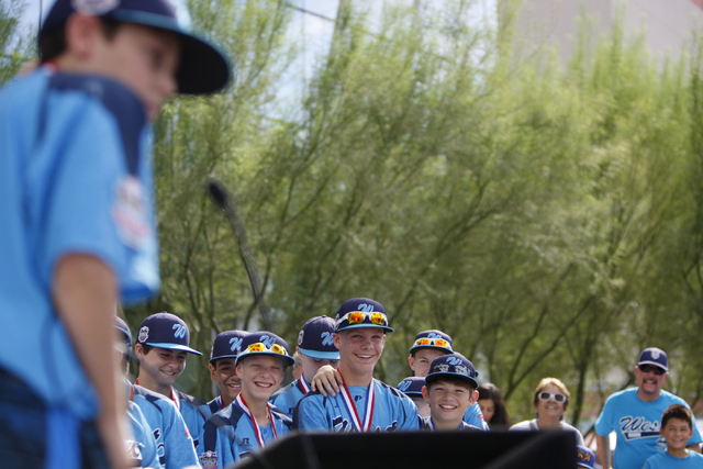 Mountain Ridge Little League player Drew Laspaluto (4) speaks for his team during a ceremony honoring them for their Little League World Series performance at Las Vegas City Hall in Las Vegas Satu ...
