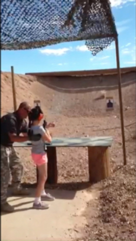 Instructor Charles Vacca, 39, of Lake Havasu City, Ariz., helps an unidentified 9-year-old girl fire a 9 mm Uzi just moments before the girl loses control of the machine gun and mistakenly shoots  ...