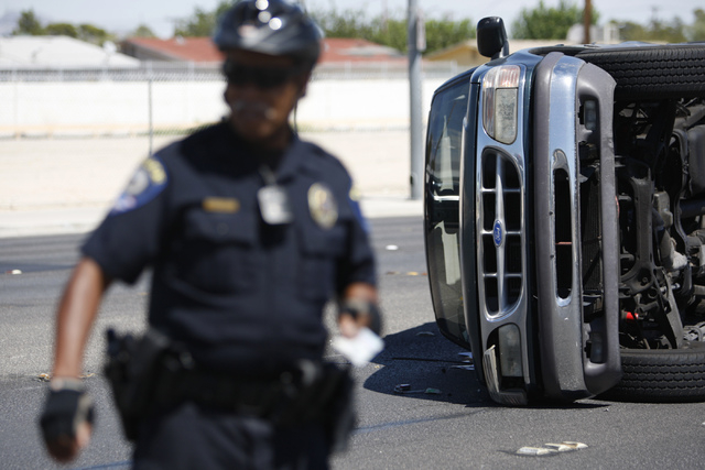 An SUV is seen flipped on its side after an accident on Lake Mead Boulevard near Tonopah Drive in Las Vegas Friday, Aug. 29, 2014. (Erik Verduzco/Las Vegas Review-Journal)