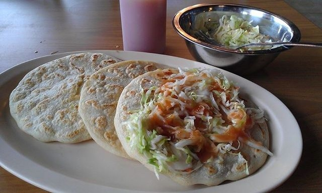 The pupusas at Las Pupusas are served with curtido, a Salvadorian cabbage salad, and a tangy sauce. (Las Vegas Review-Journal file)