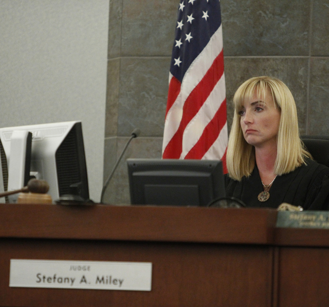 District Judge Stefany Miley listens to closing arguments in the trial of Michael Lee at the Regional Justice Center in Las Vegas Friday, Aug. 15, 2014. Lee is accused in the beating death of his  ...