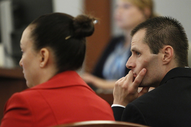 Michael Lee, right, listens to closing arguments on his trial at the Regional Justice Center in Las Vegas Friday, Aug. 15, 2014. Lee is accused in the beating death of his fomer girlfriend's 2-yea ...