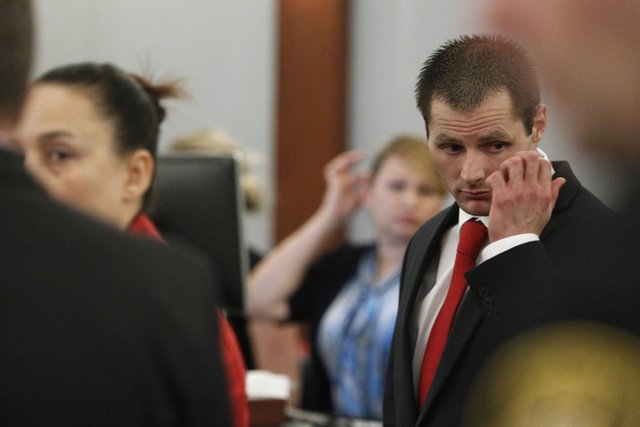 Michael Lee, right, stands for the jury during closing arguments on his trial at the Regional Justice Center in Las Vegas Friday, Aug. 15, 2014. Lee is accused in the beating death of his fomer gi ...