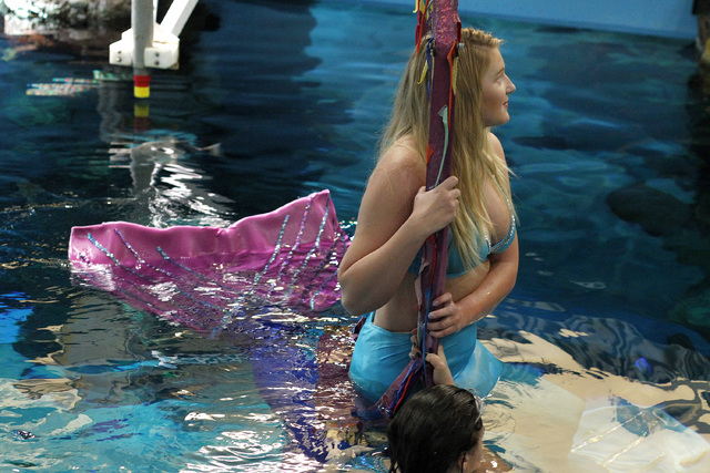 Kaitlyn Gilmore, top, and Logan Halverson are mermaids inside The Aquarium at the Silverton, 3333 Blue Diamond Road. (Alex Corey/View)