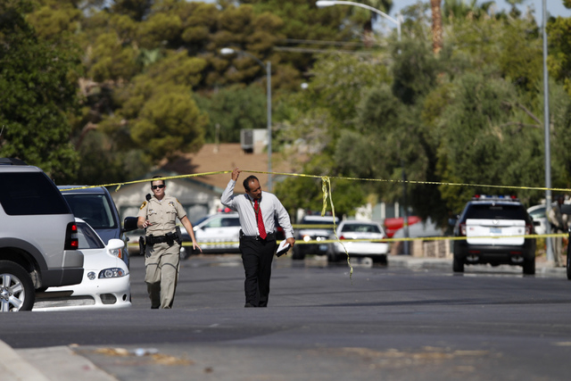 Police investigate the scene of a home invasion and shooting at the corner of Autumn Street and Rollingwood Drive in Las Vegas Tuesday, July 29, 2014. A second victim shot during the home invasion ...