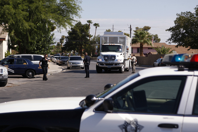 A Las Vegas police mobile command center arrives at the scene of a home invasion and shooting at the corner of Autumn Street and Rollingwood Drive in Las Vegas, Tuesday, July 29, 2014. A second vi ...