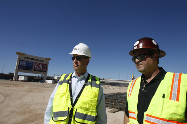 Rob Stephens, left, senior vice president at ICON Venue Group, and Anthony Leone, director of construction development at MGM Resorts International, give a tour of the construction site of the MGM ...