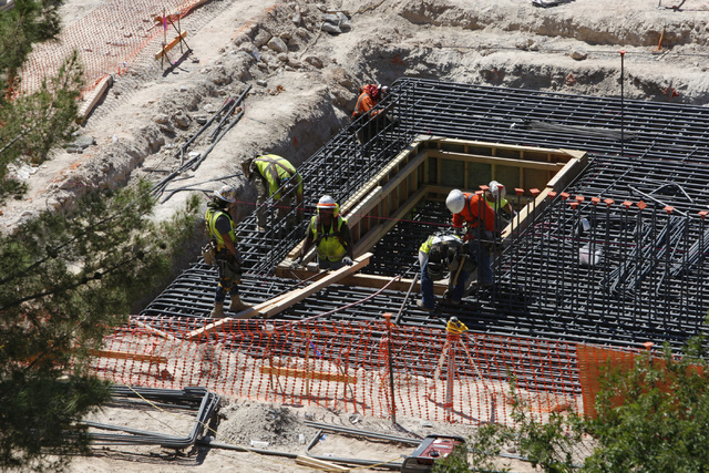 Construction workers set up the foundation for the first vertical wall at the construction site of the new MGM Resorts International and AEG indoor arena located behind the New York-New York casin ...