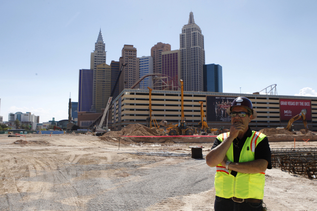 Anthony Leone, director of construction development at MGM Resorts International, gives a tour of the construction site of the MGM Resorts International and AEG indoor arena located behind the New ...