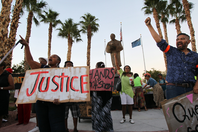 People chant during a peace rally and vigil for Michael Brown at the Martin Luther King Jr. statue on the corner of North Martin Luther King Boulevard and West Carey Avenue in North Las Vegas Thur ...