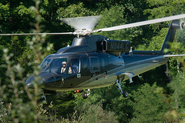 A search helicopter lands close to the scene where an Air Force F-15C fighter jet based in Massachusetts crashed near Deerfield, Virginia, on Wednesday, Aug. 27, 2014. The jet was on a standard tr ...