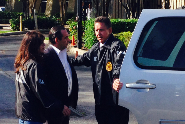 In this photo provided by ESPN, Anthony Bosch, center, is escorted by Drug Enforcement Administration officials in Weston, Fla., Tuesday, Aug. 5, 2014. The owner of a now-defunct Florida clinic wa ...