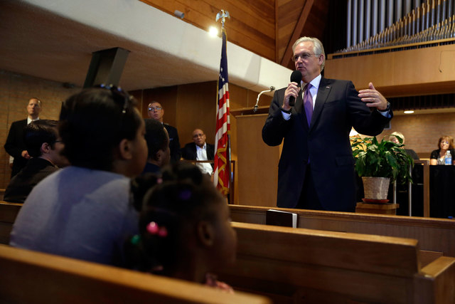"Missouri Gov. Jay Nixon speaks during a meeting of clergy and community members, Thursday, Aug. 14, 2014, in Florissant, Mo. Nixon says ""operational shifts"" are ahead for law enforcement in the St ..."
