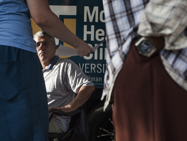 Patient Lucas Pollack sits at the Touro University Nevada Mobile Healthcare Clinic in the homeless corridor on Foremaster Lane on Wednesday, Aug.13, 2014. Touro recently begin providing mobile hea ...