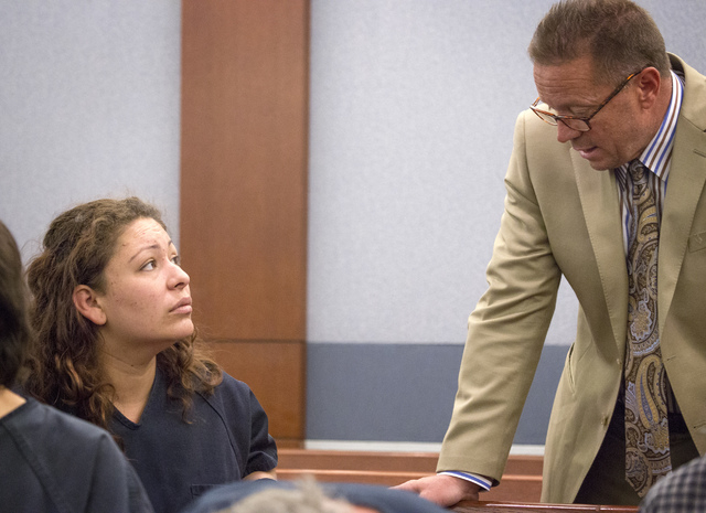Shavon Carrillo, the mother who faces an attempted murder charge in the shooting of her 11-year-old son, speaks to Clark County Public Defender Gary Guymon during her initial appearance at Regiona ...