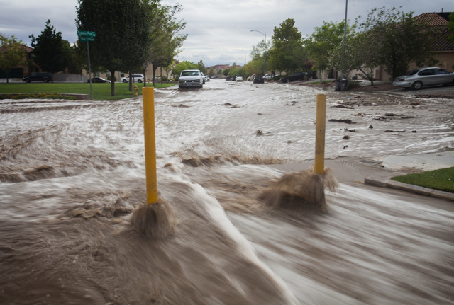 A flooded Shade Pines Drive in northwest Las Vegas as seen on Monday, Aug. 4, 2014. Overnight monsoon rains caused flooding in the area. (Jeff Scheid/Las Vegas Review-Journal)