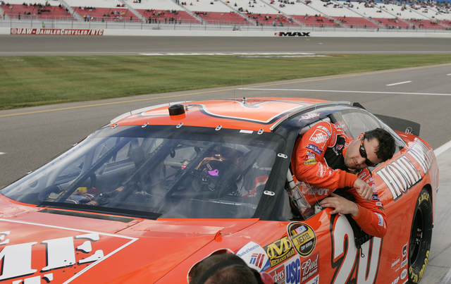 RJ FILE*** SPORTS - Tony Stewart gets out of his car after qualifying for the NASCAR UAW-DaimlerChrysler 400 at the Las Vegas Motor Speedway in Las Vegas Friday, March 10, 2006. The race takes pla ...