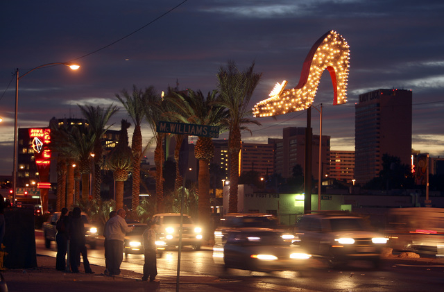 JOHN GURZINSKI/LAS VEGAS REVIEW JOURNAL The restored giant spiked high-heal shoe that used to be part of the marquee sign for the Silver Slipper Gambling Hall is shown along Las Vegas Boulevard on ...