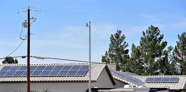 A Las Vegas home with solar panels installed on its roof is seen on Monday, June 16, 2014. The state Public Utilities Commission is moving forward with a review of whether households that produce  ...
