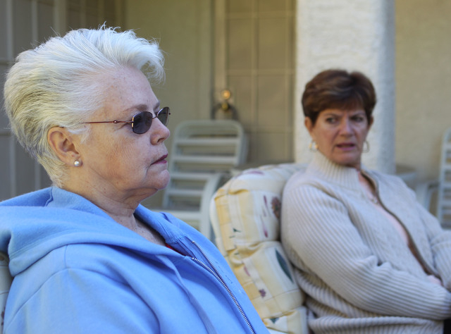 Dee Redwine, left, and Shirley Newsham, both of Las Vegas, discuss Sandi Niccum's painful experiences with the Veterans Administration while talking to a reporter in Las Vegas, Monday, Nov. 25, 20 ...