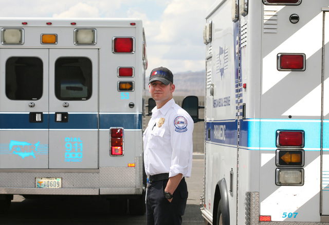 Frank Marchionne, operations supervisor and paramedic at American Medical Response, stands near two ambulances at American Medical Response Tuesday, Aug. 12, 2014, in Las Vegas. Marchionne worked  ...