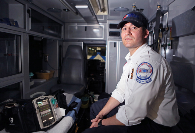 Frank Marchionne, operations supervisor and paramedic at American Medical Response, sits in an ambulance at American Medical Response Tuesday, Aug. 12, 2014, in Las Vegas. Marchionne worked night  ...