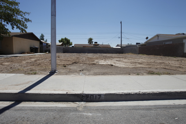 A vacant lot where a home once stood at 2017 Balzar Ave. in North Las Vegas, is seen on Friday, Aug. 30, 2014. The property was demolished by city officials as part of a city program to remove ars ...