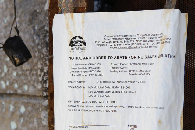 A notice is seen at a burned down home at 2116 Carver Ave. in North Las Vegas Friday, Aug. 29, 2014. North Las Vegas officials plan to demolish arson-plagued homes as part of a city program. (Erik ...