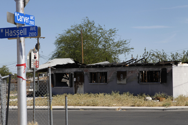 A burned down home is seen at 2116 Carver Ave. in North Las Vegas Friday, Aug. 29, 2014. North Las Vegas officials plan to demolish arson-plagued homes as part of a city program. (Erik Verduzco/La ...